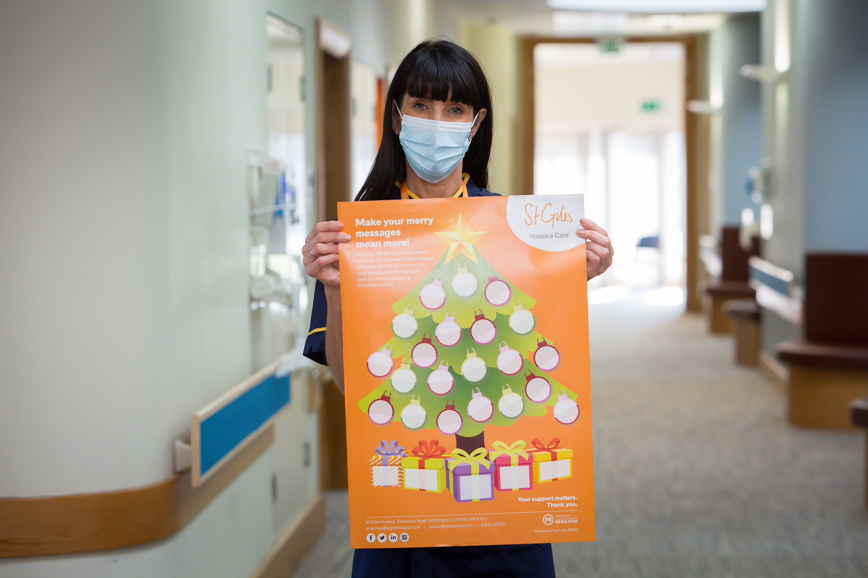 St Giles Hospice Clinical Director Katie Burbridge with the Merry Messages poster